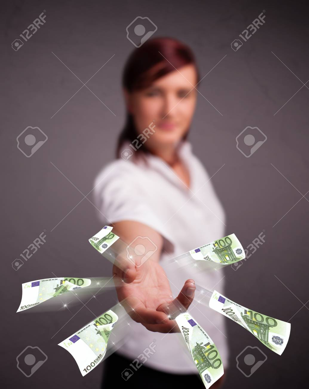 Pretty young woman standing and throwing money Stock Photo - 17738627