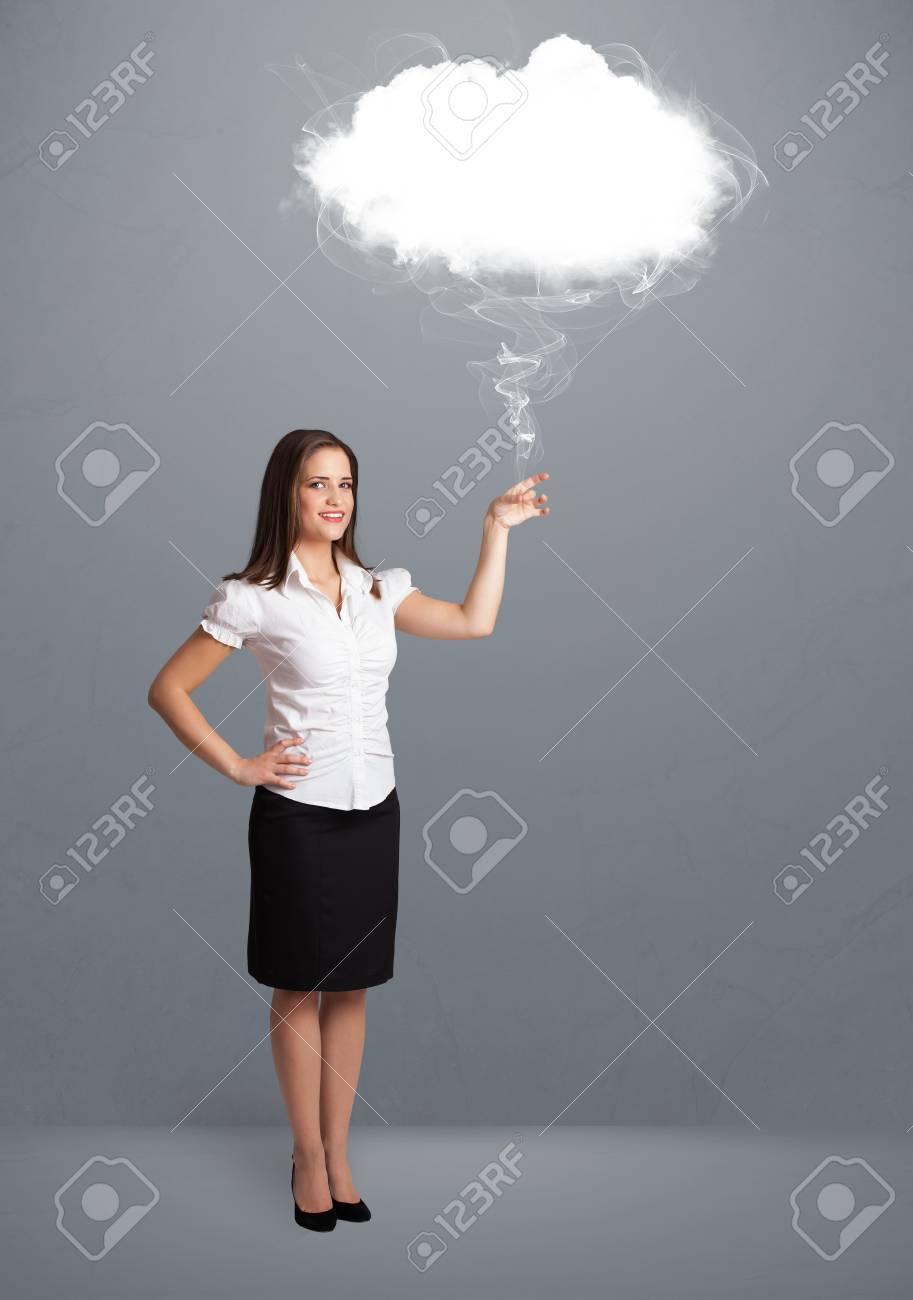 Beautiful young woman holding cloud Stock Photo - 17737312