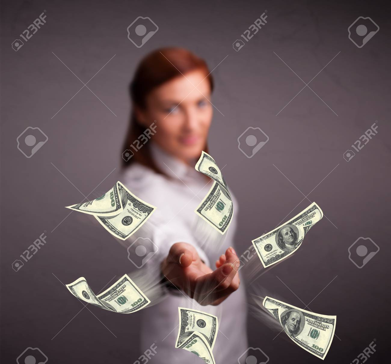 Beautiful young girl throwing money Stock Photo - 17784565