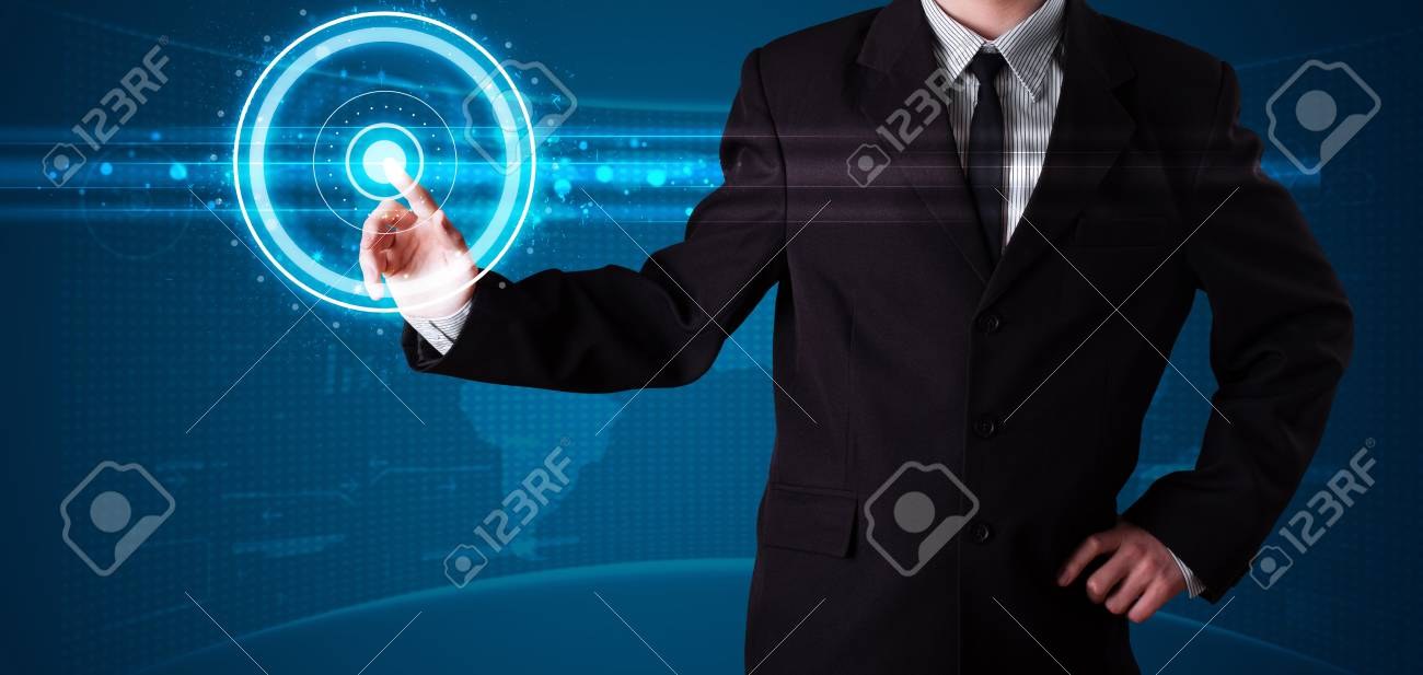 Young businessman pressing high tech type of modern buttons Stock Photo - 17988958