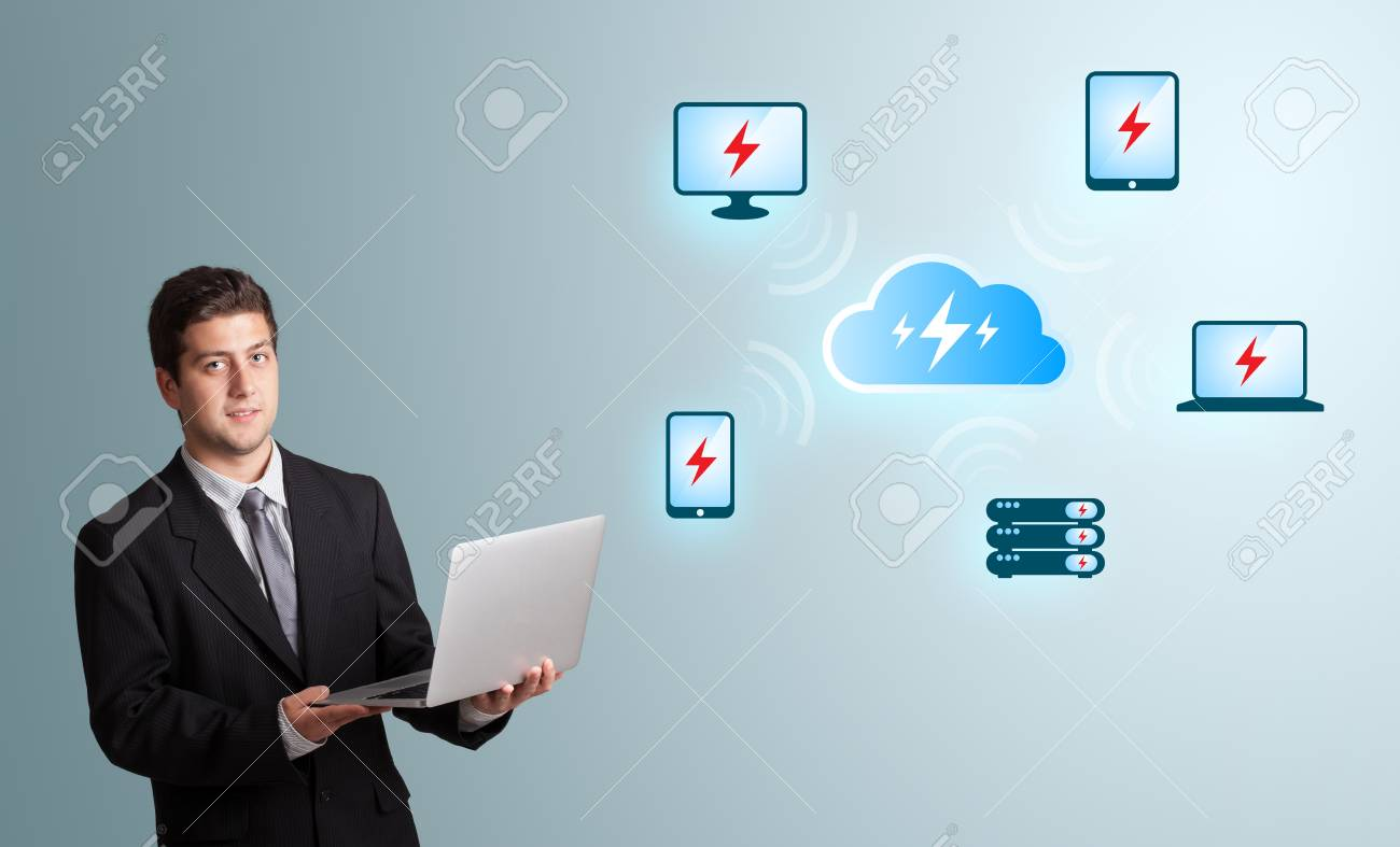 Handsome young man holding a laptop and presenting cloud computing network Stock Photo - 18072882