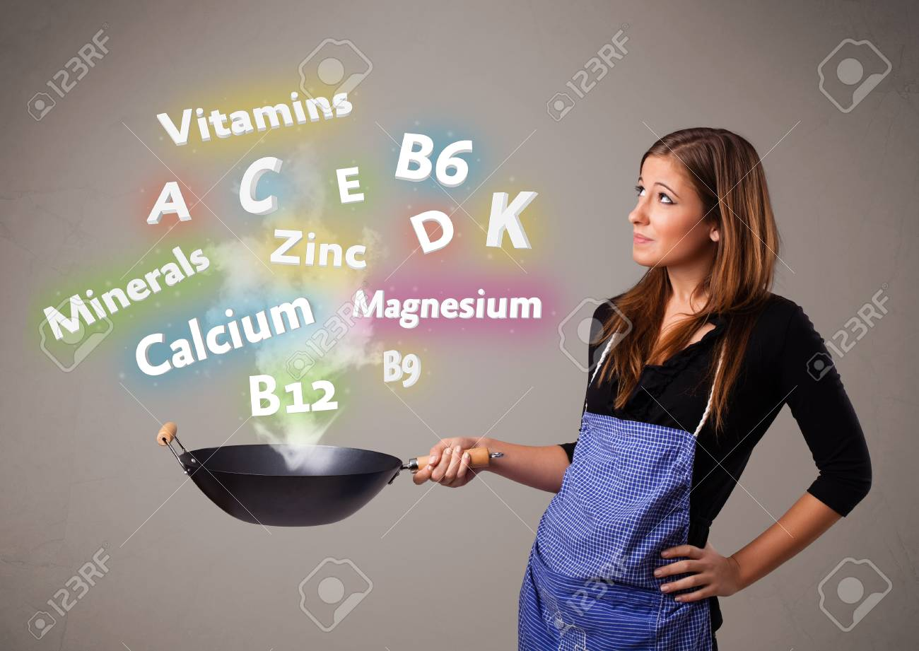 Pretty young woman cooking vitamins and minerals Stock Photo - 19124342