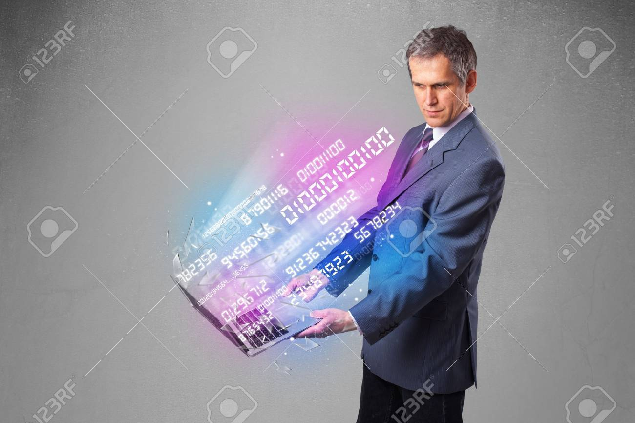Attractive businessman holding notebook with exploding data and numbers Stock Photo - 19124382