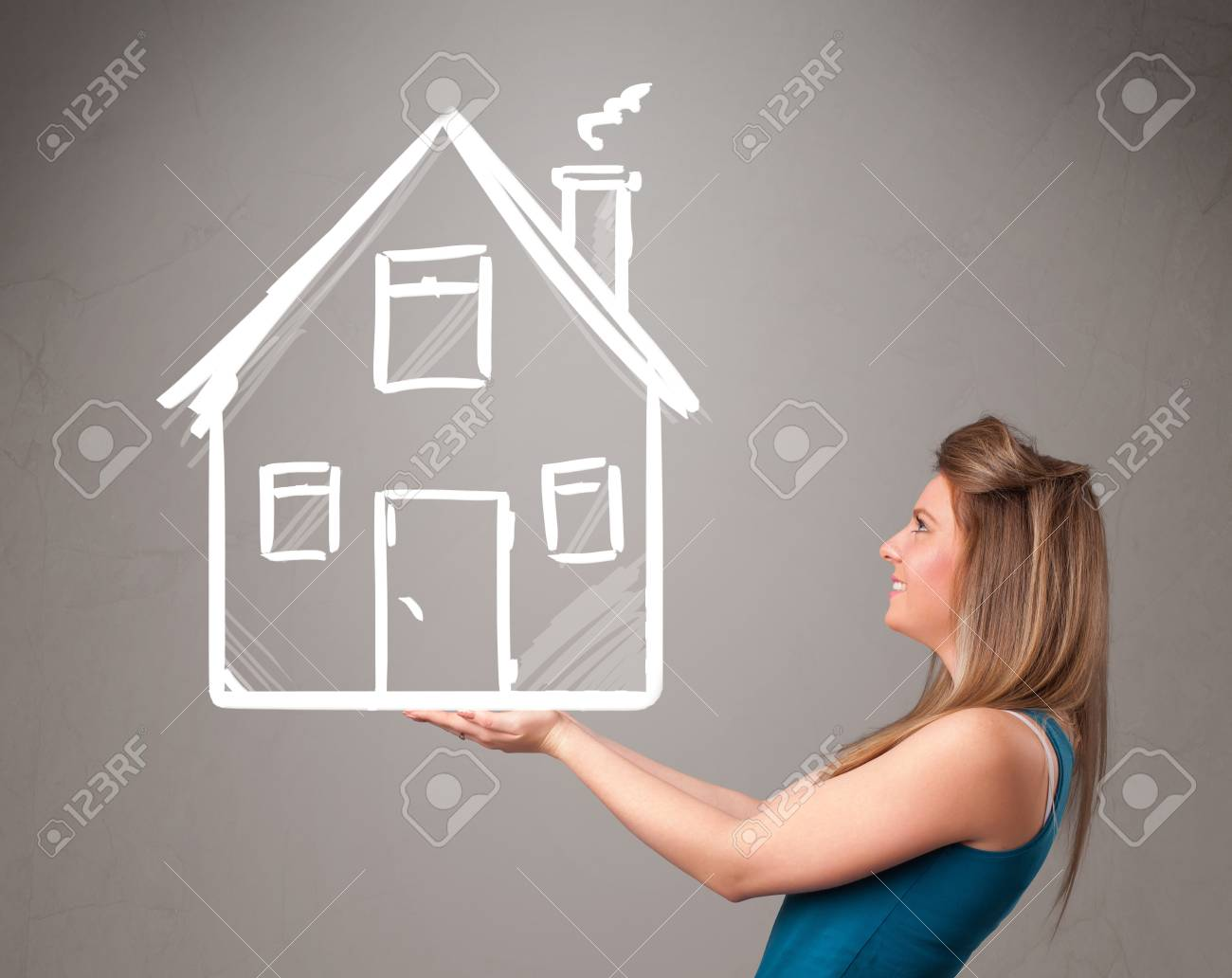 Beautiful young lady holding a huge drawn house Stock Photo - 19664583