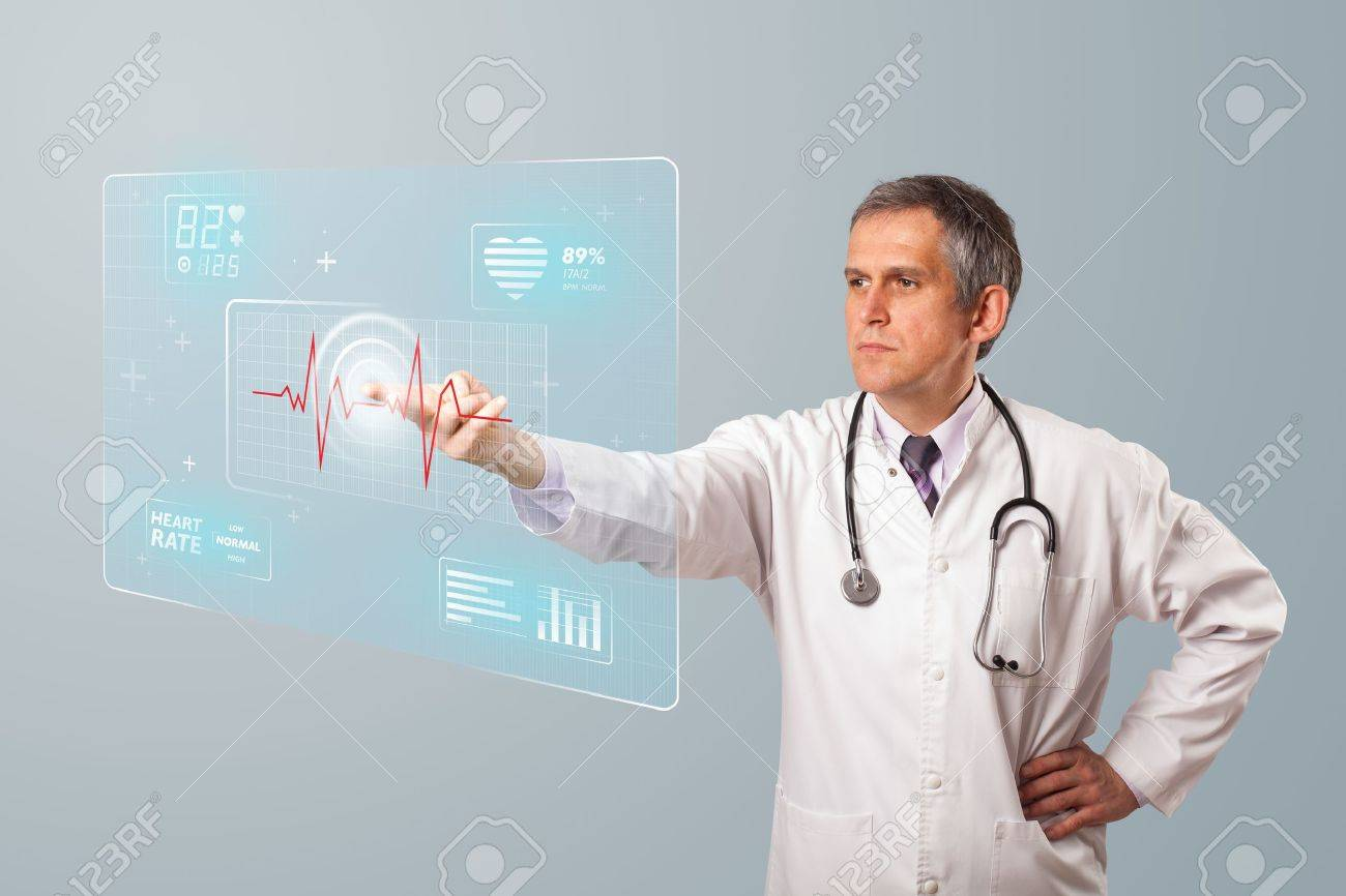 Middle aged doctor standing and pressing modern medical type of button Stock Photo - 19789605