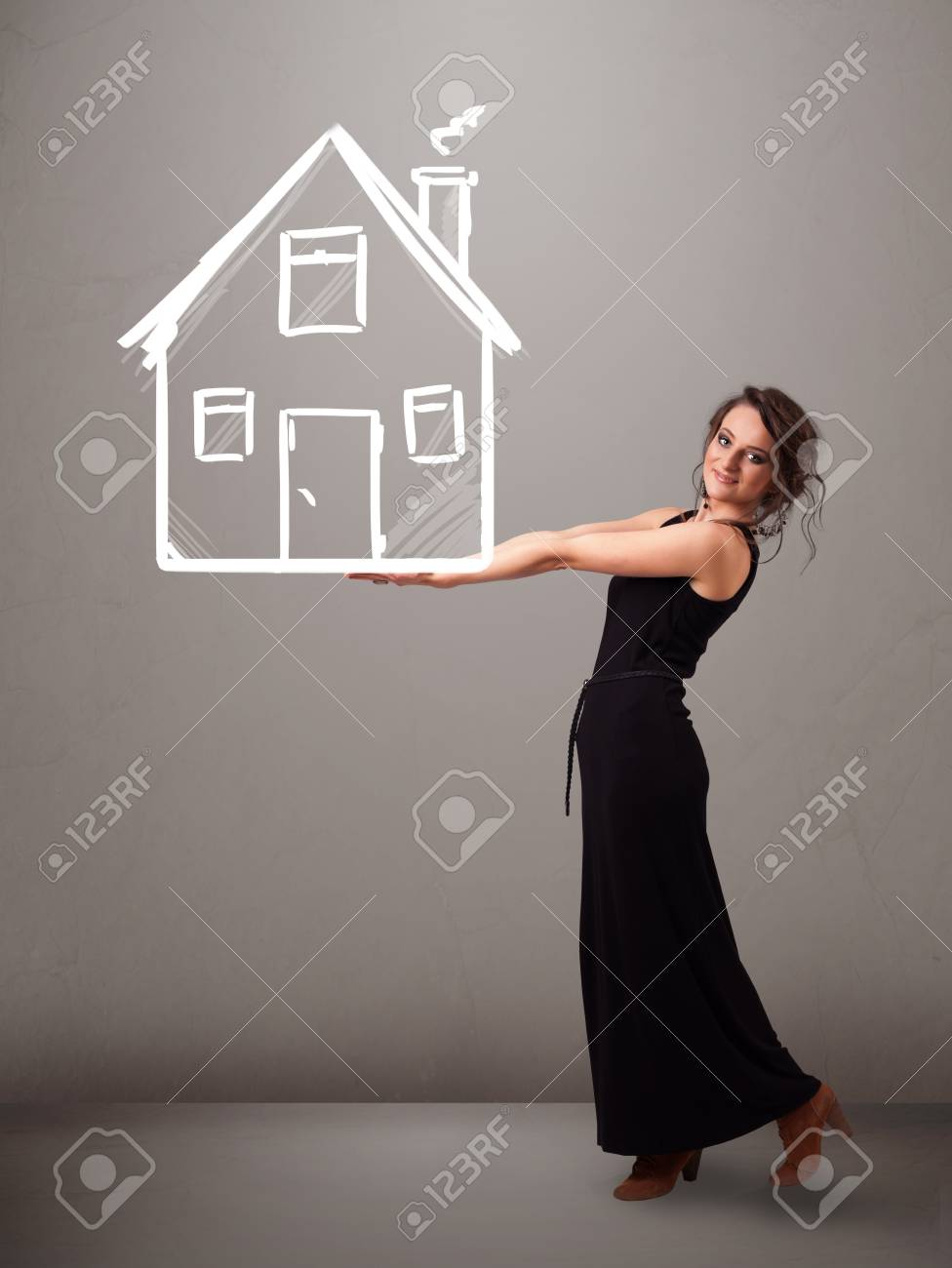 Beautiful young lady holding a huge drawn house Stock Photo - 20524019