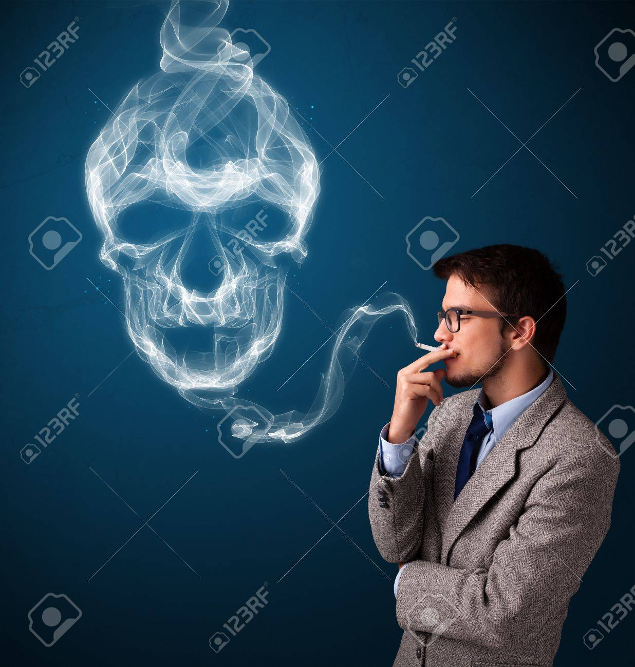 Handsome young man smoking dangerous cigarette with toxic skull smoke Stock Photo - 21017585