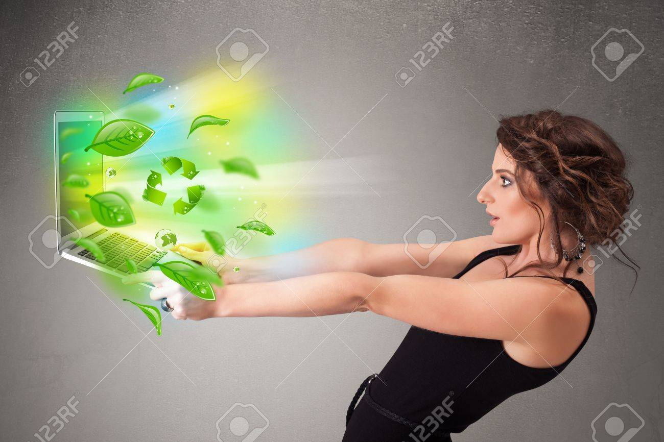 Casual young woman holding notebook with recycle and environmental symbols Stock Photo - 21017896