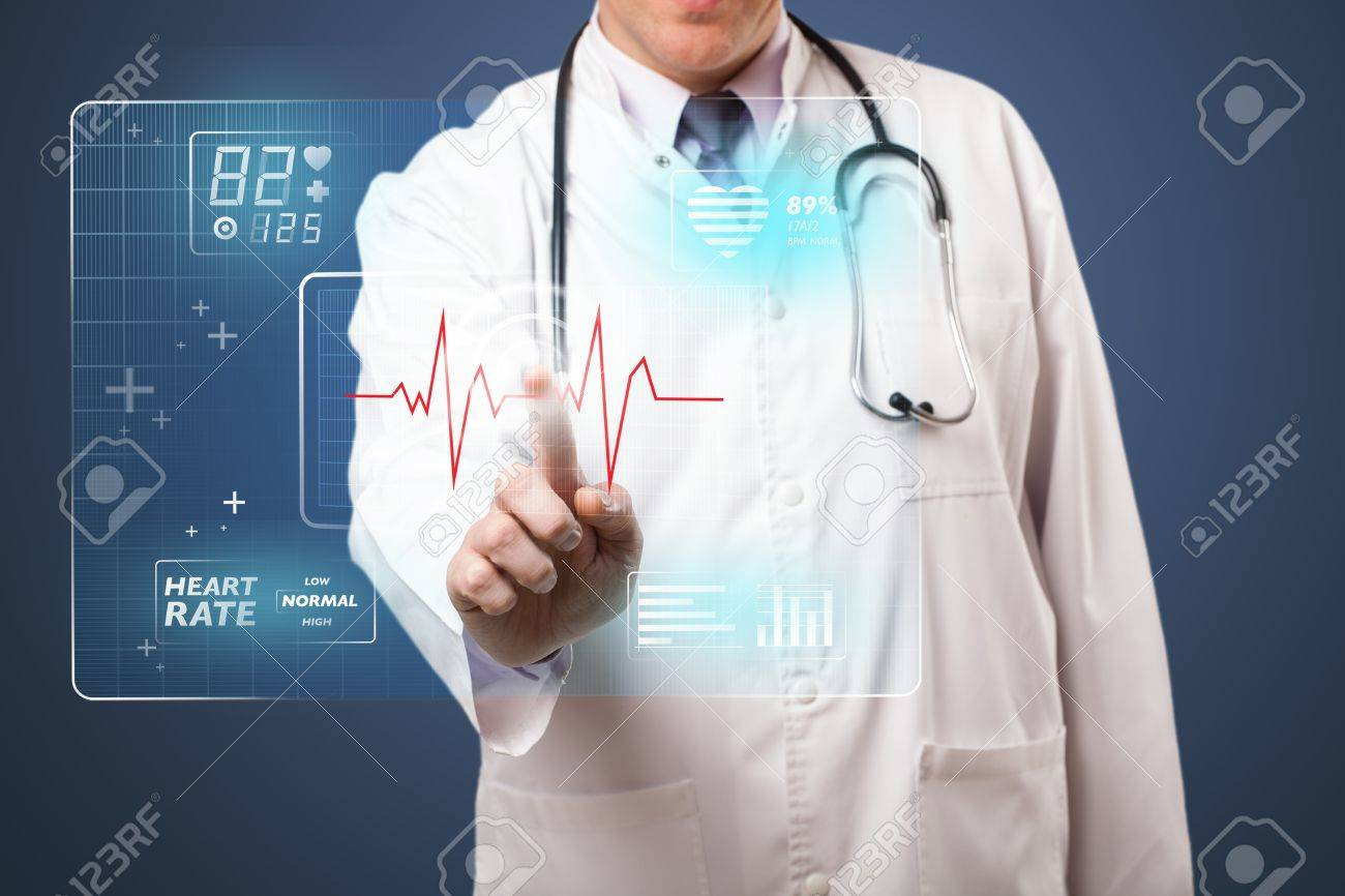 Middle aged doctor standing and pressing modern medical type of button Stock Photo - 21297882