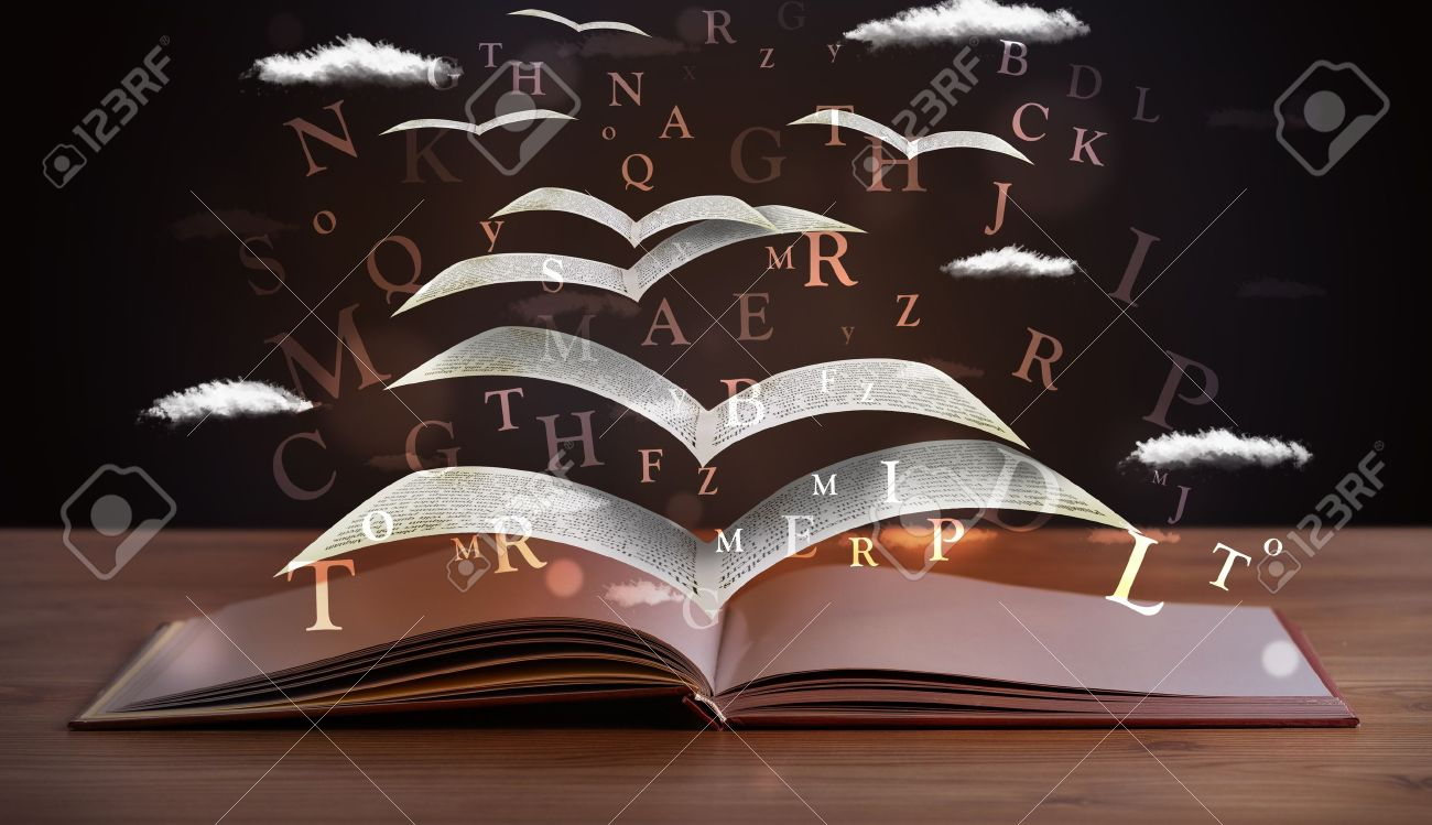 Pages and glowing letters flying out of a book on wooden deck Stock Photo - 21739982