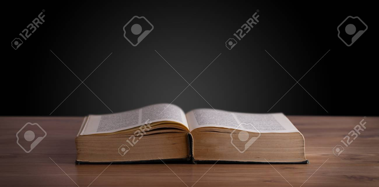 Open book on wooden deck and copy space Stock Photo - 22756757