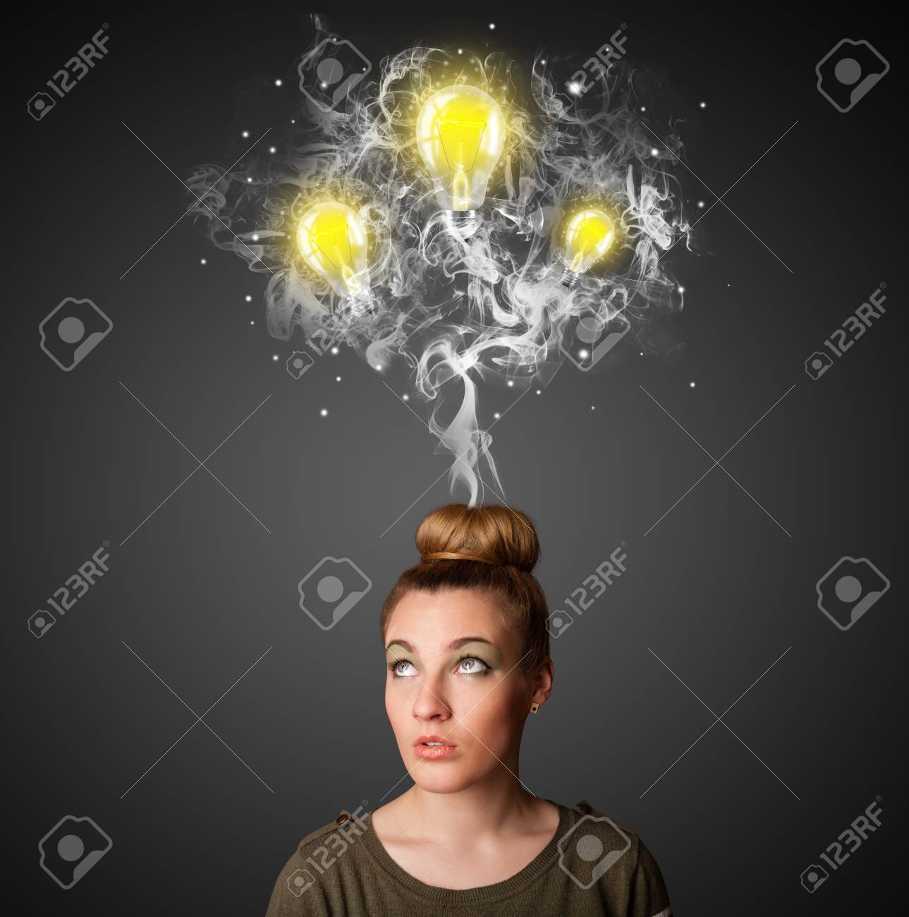 Pretty young woman with smoke and lightbulbs above her head Stock Photo - 23340742