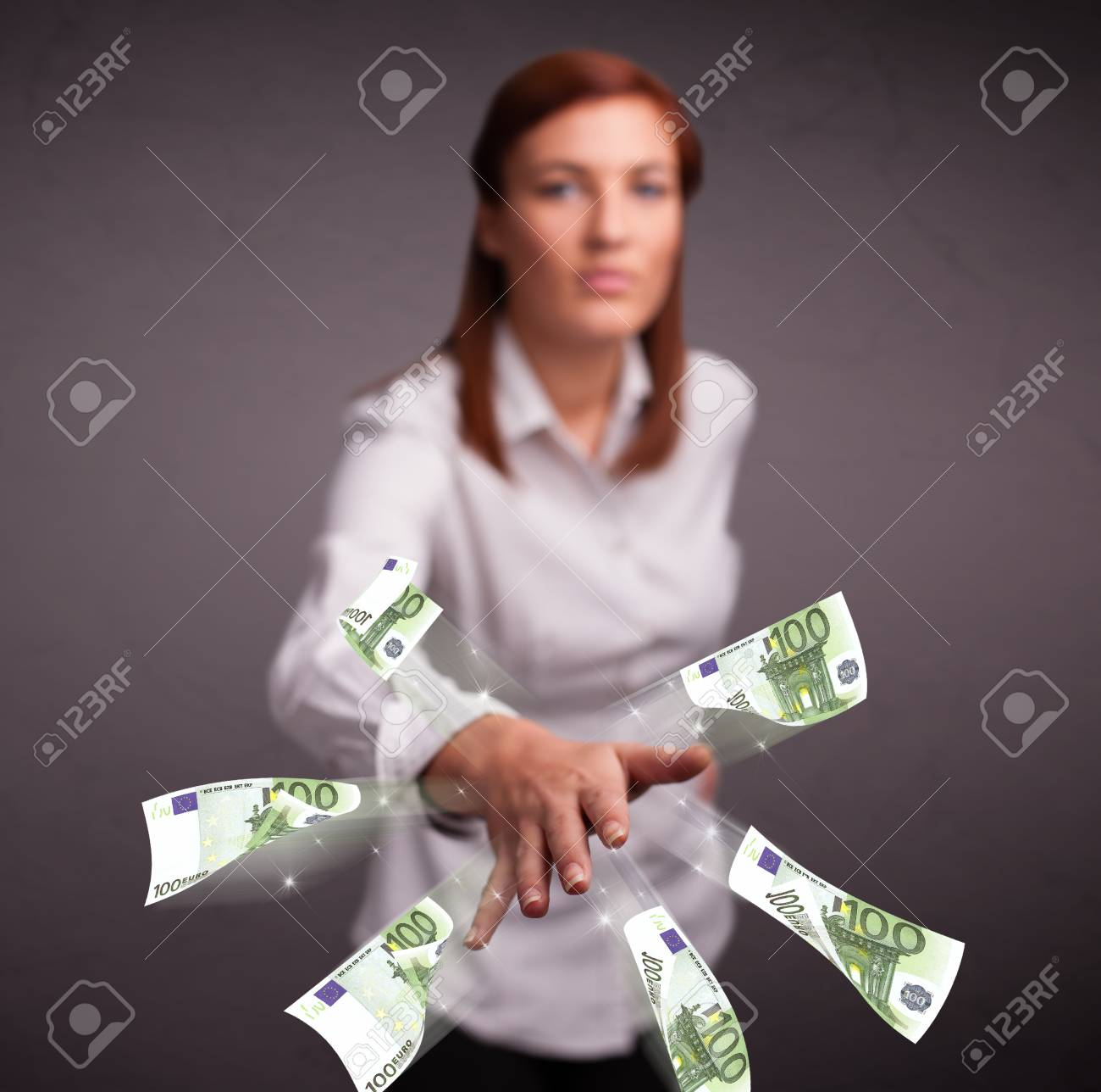 Pretty young woman standing and throwing money Stock Photo - 23371843