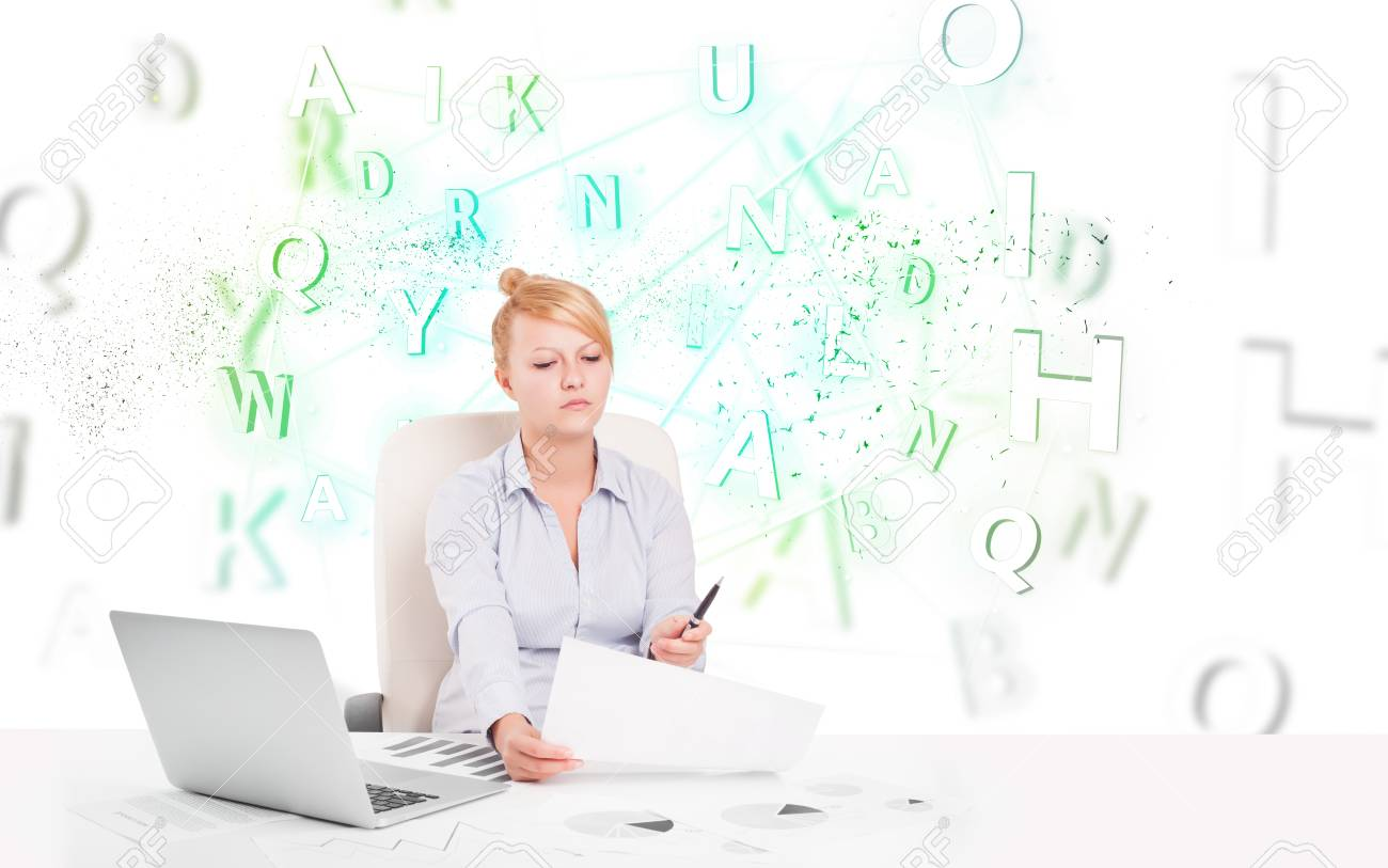 Business woman at white desk with green word cloud Stock Photo - 24636770