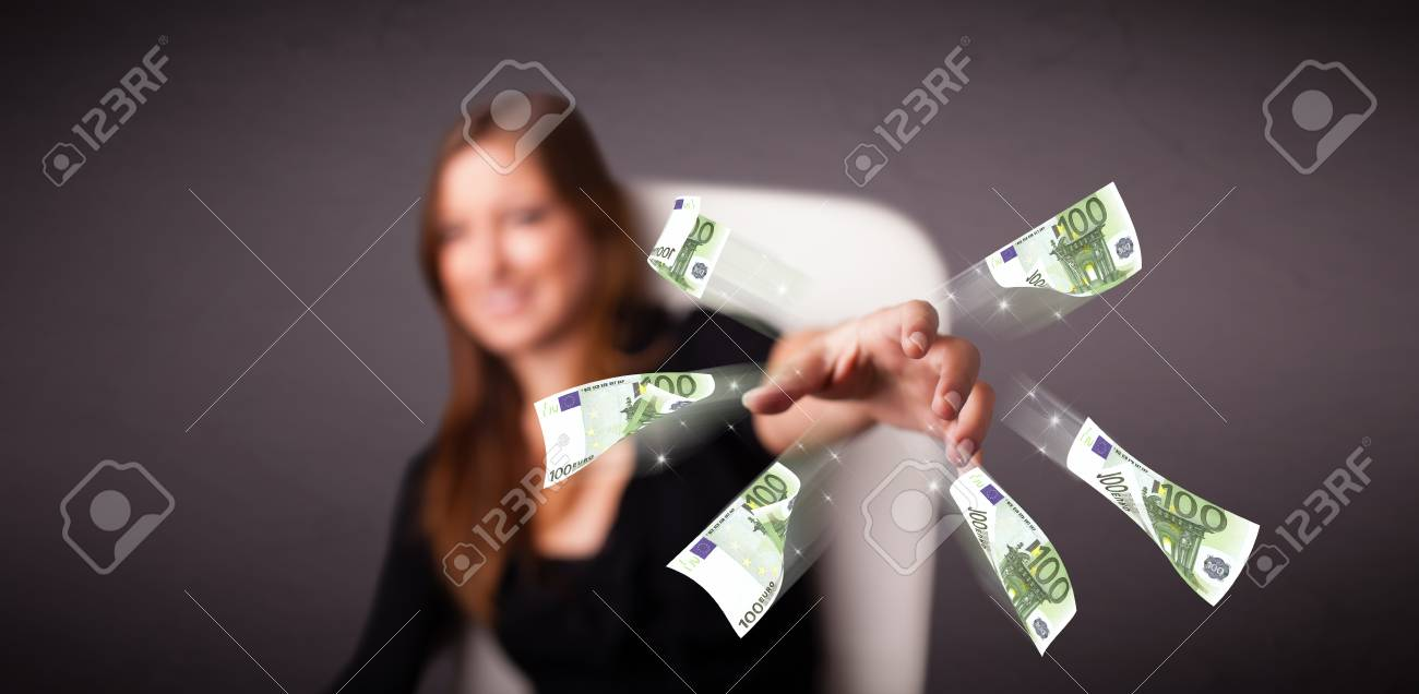 Pretty young woman sitting and throwing money Stock Photo - 26563985
