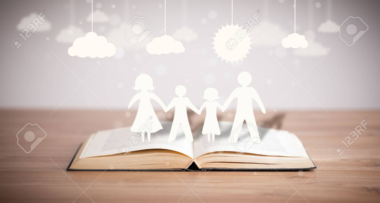 Cardboard Figures Of The Family On Opened Book The Symbol Of
