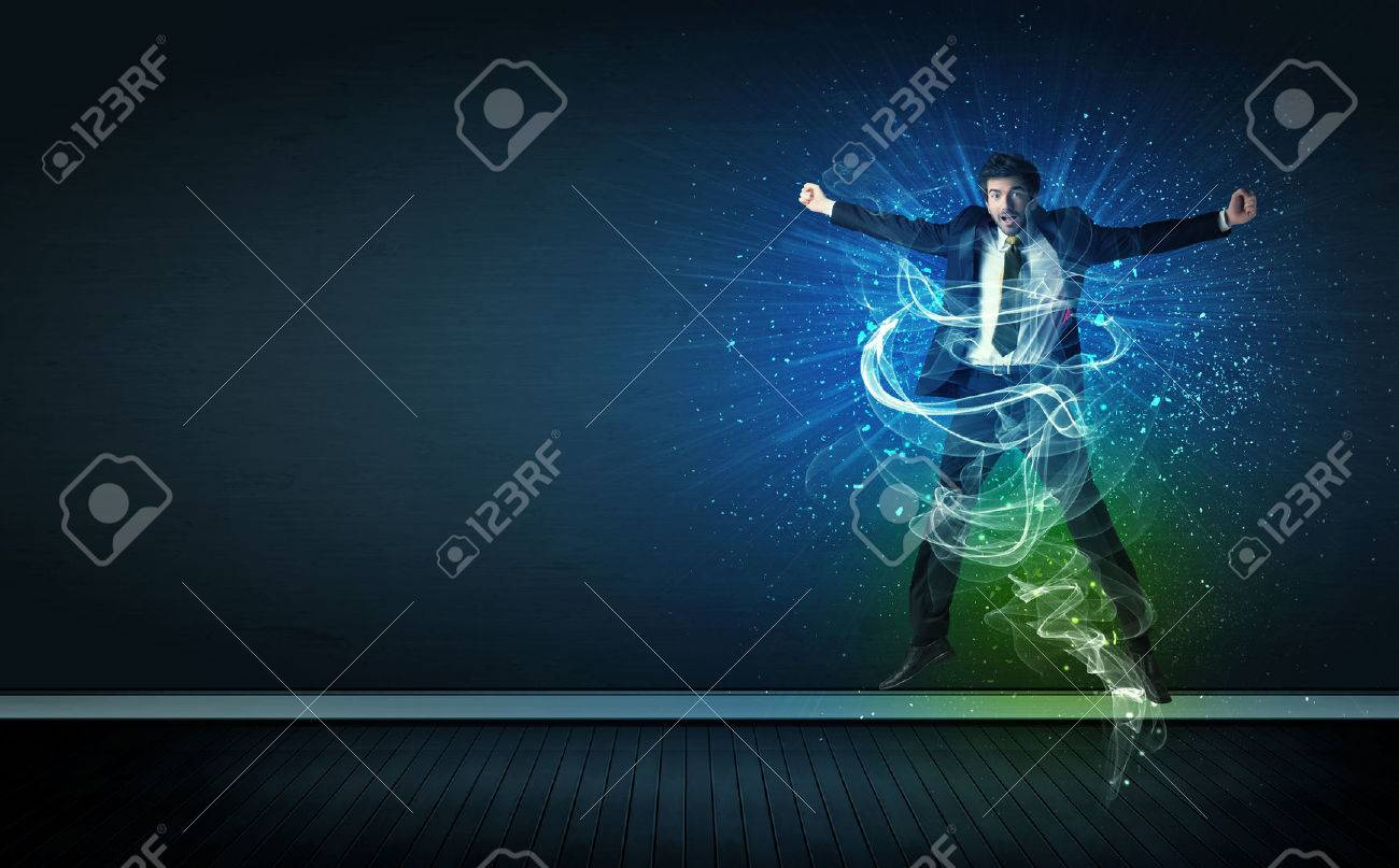 Talented cheerful businessman jumping with glowing energy lines on background Stock Photo - 34713685
