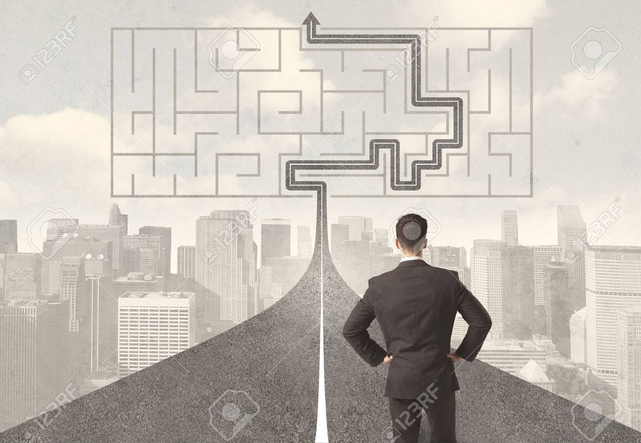 Businessman looking at road with maze and solution concept Stock Photo - 34621777