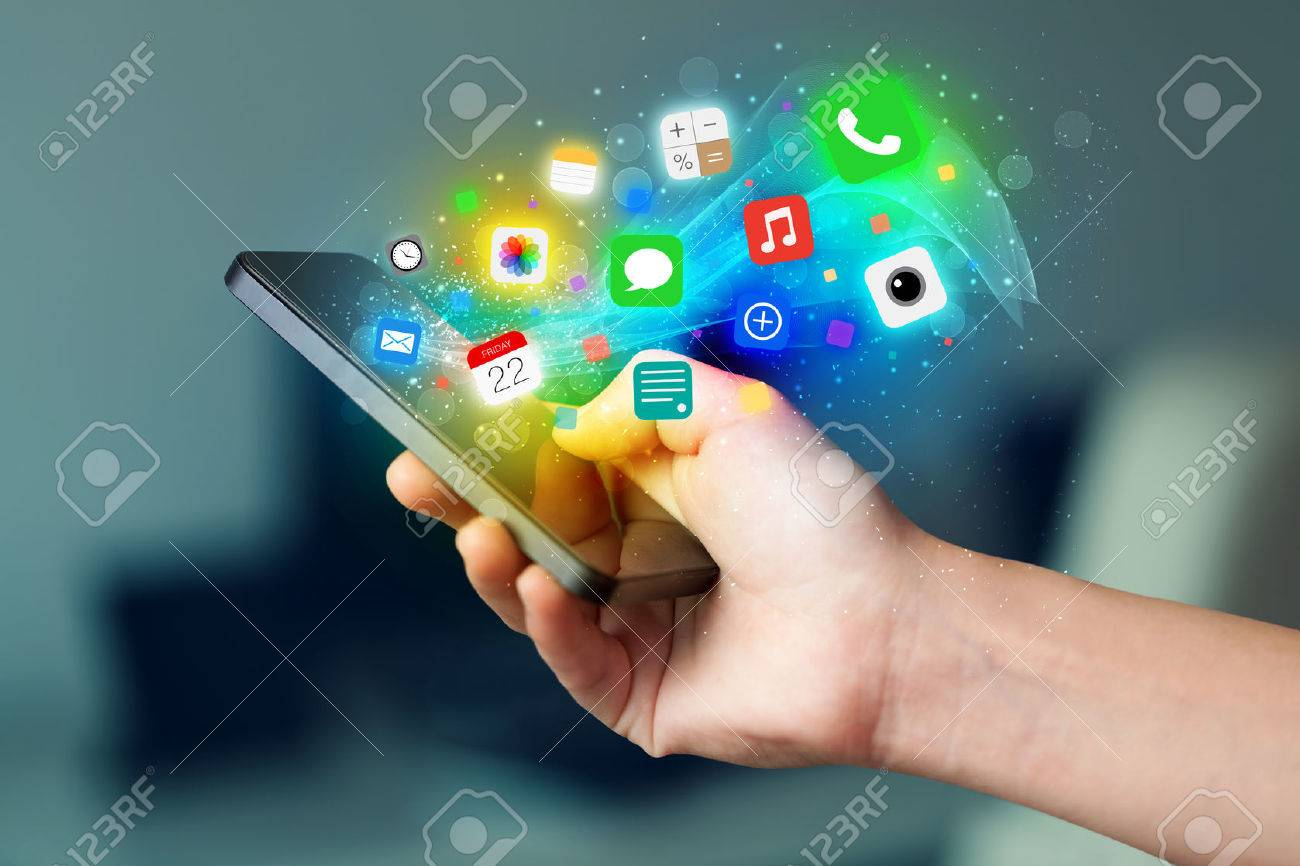 Hand holding smartphone with colorful app icons concept Stock Photo - 35147112