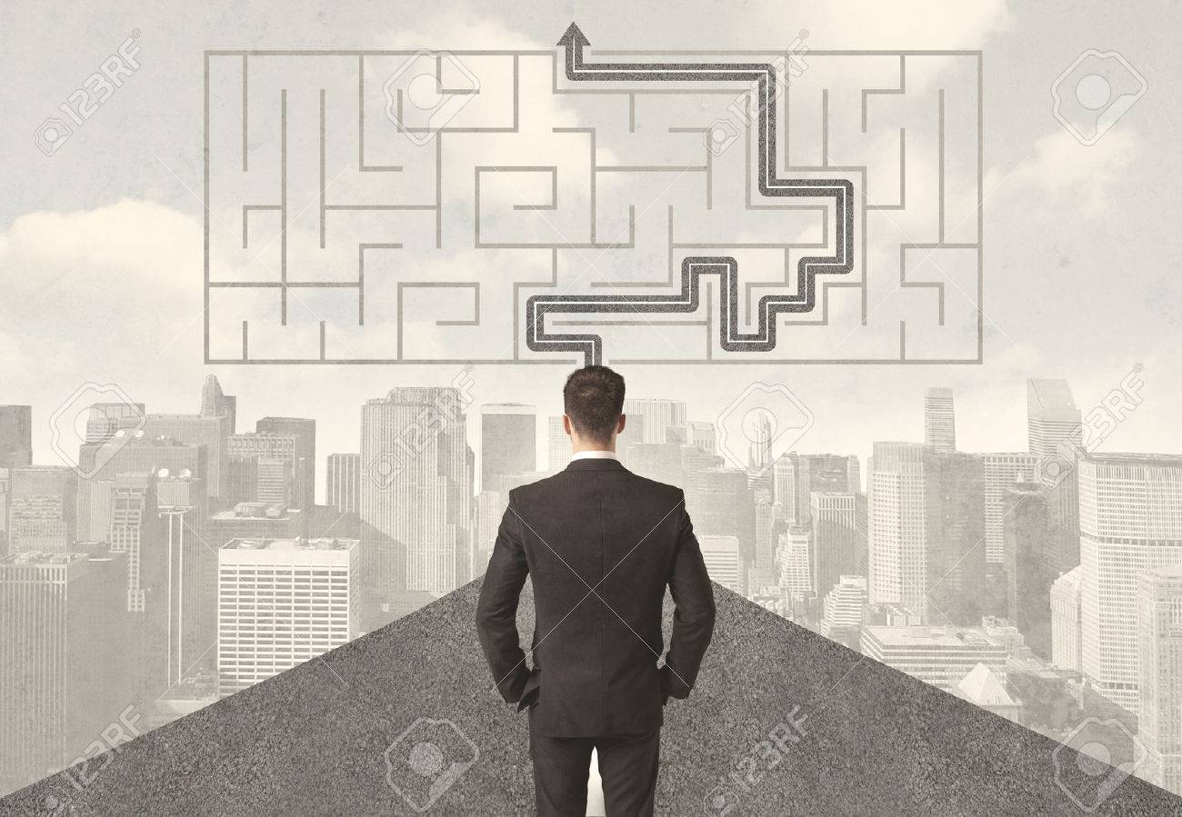 Businessman looking at road with maze and solution concept Stock Photo - 35325854