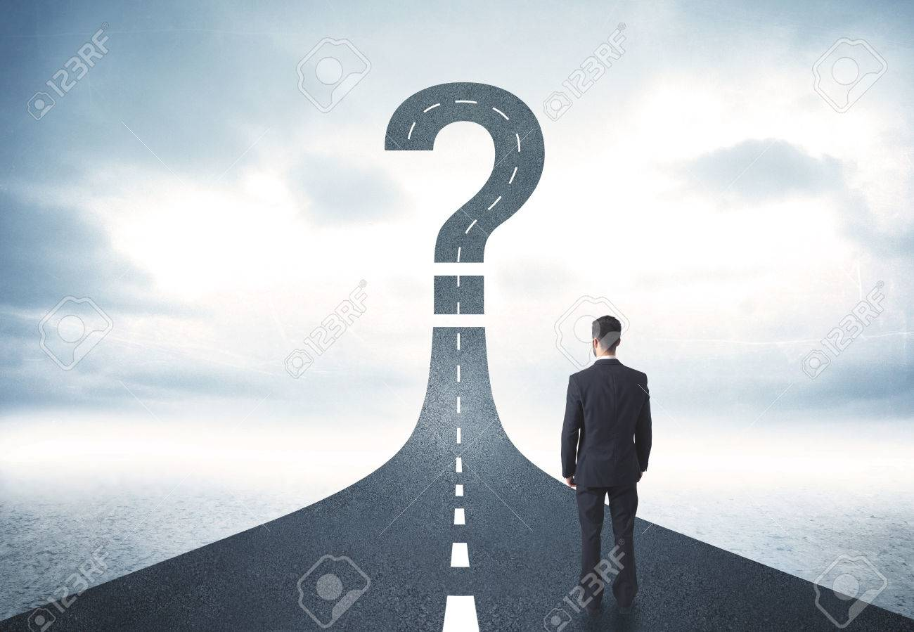 Business person lokking at road with question mark sign concept Stock Photo - 35578259