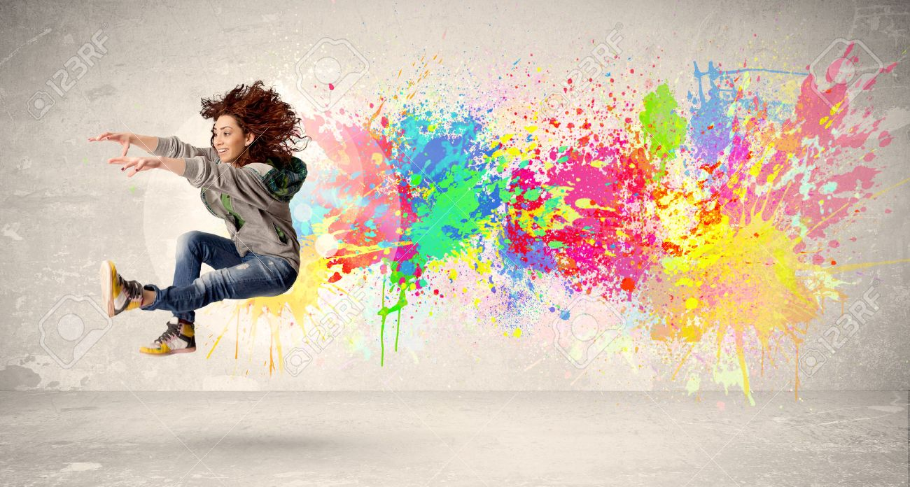 Happy teenager jumping with colorful ink splatter on urban background concept Stock Photo - 37961595