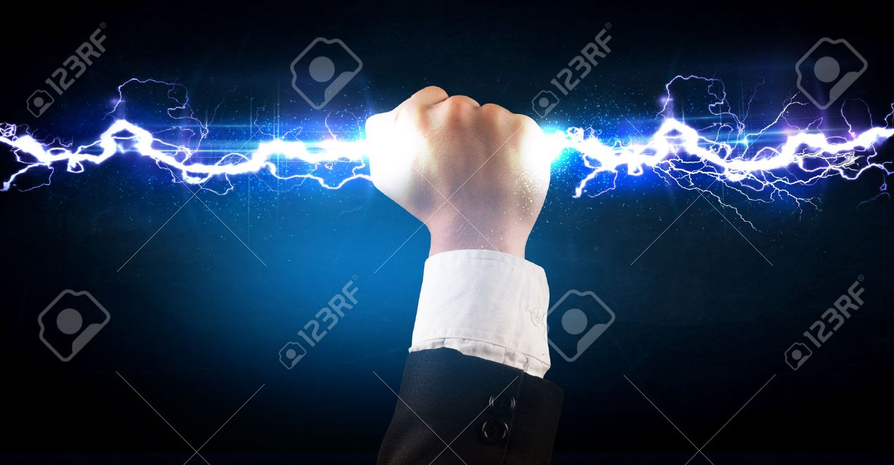 Business man holding electricity light bolt in his hands concept Stock Photo - 38003013