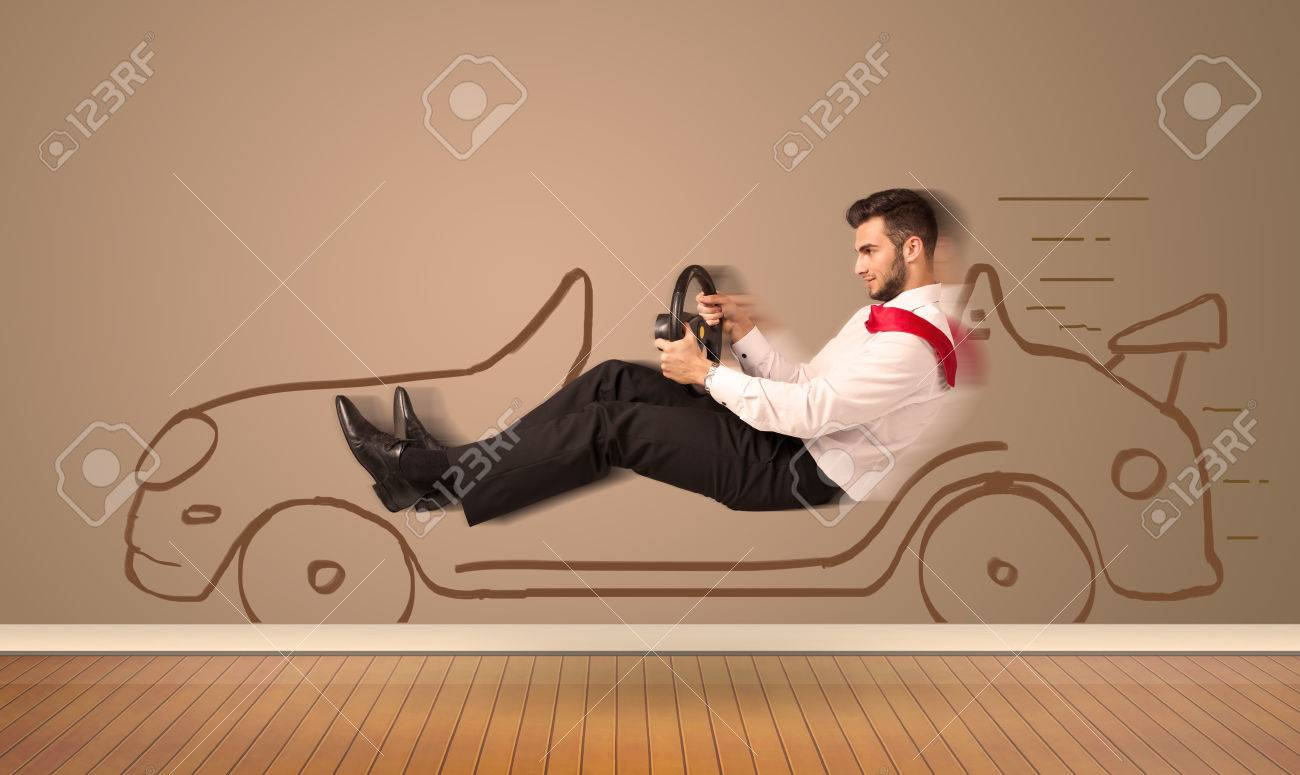 Happy man driving an hand drawn car on the wall concept Stock Photo - 38268495