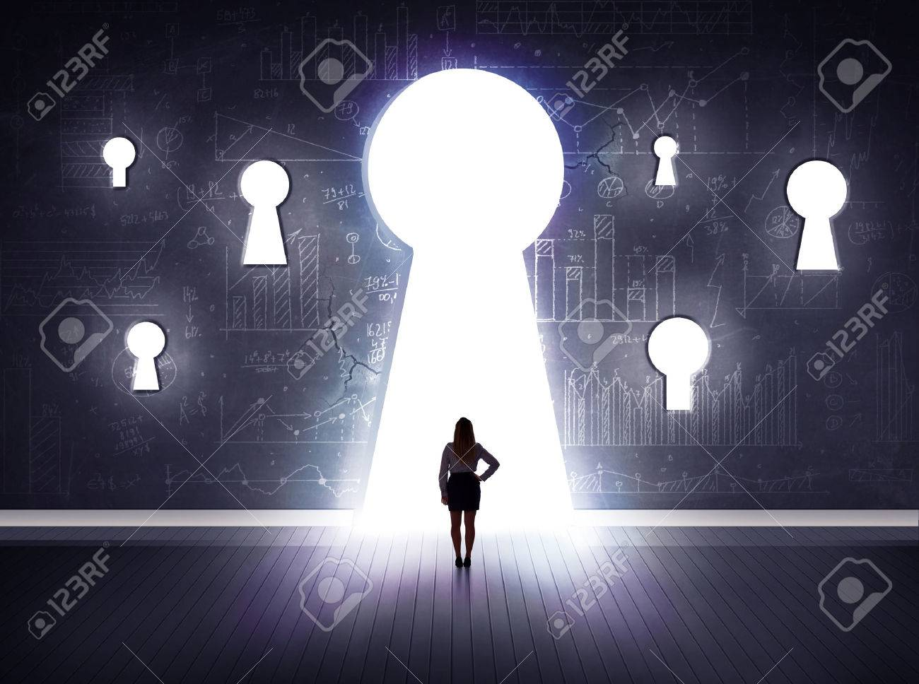 Successful businessman looking through keyhole Stock Photo - 38490714