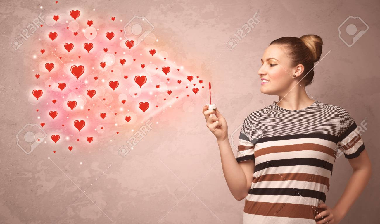 Pretty Young Girl Blowing Valentine Red Heart Symbols Stock Photo