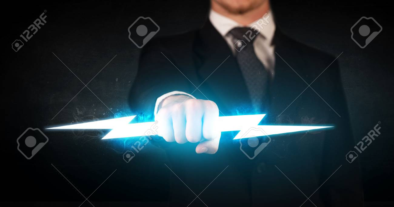 Business Man Holding Glowing Lightning Bolt In His Hands Concept Stock Photo Picture And Royalty Free Image Image 39334526