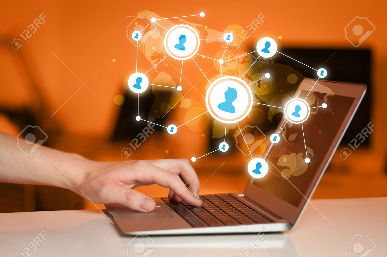 Close up of hand with laptop and social media network icons Stock Photo - 39764412
