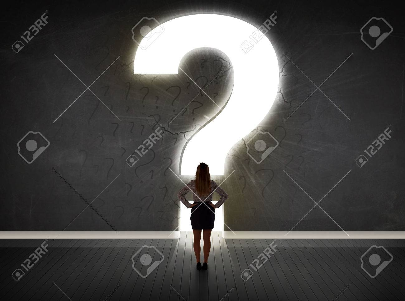 Business woman looking at wall with a bright question mark concept Stock Photo - 40246419