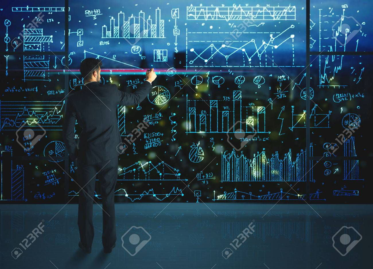 Businessman drawing business statistics on glass wall Stock Photo - 40355128
