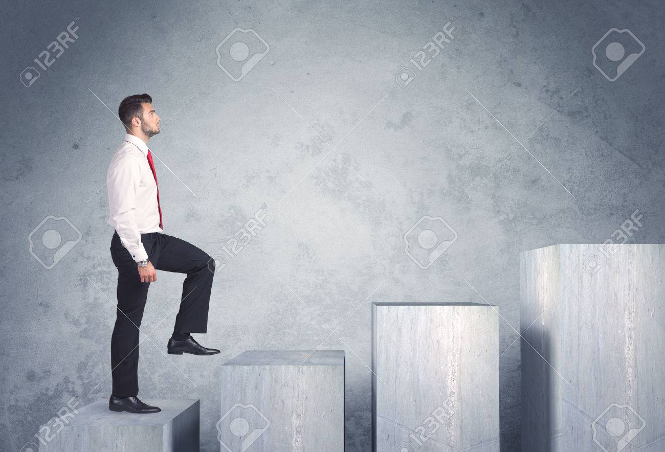 Business person stepping up a staircase Stock Photo - 40809268
