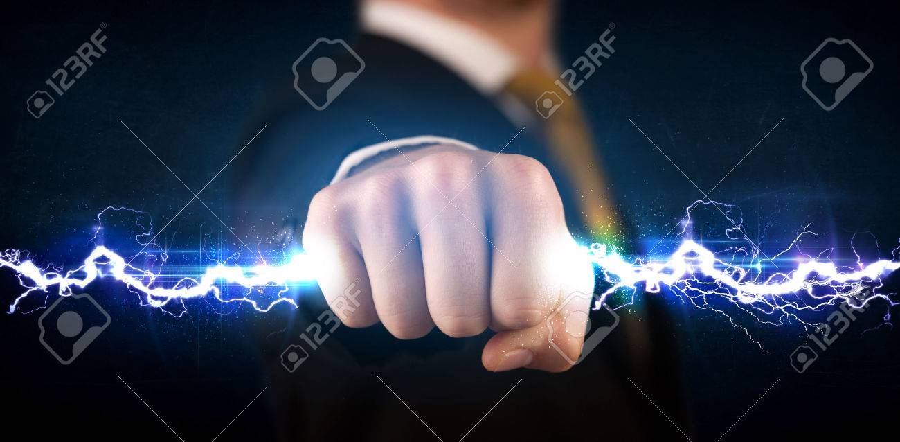 Business man holding electricity light bolt in his hands concept Stock Photo - 42441924
