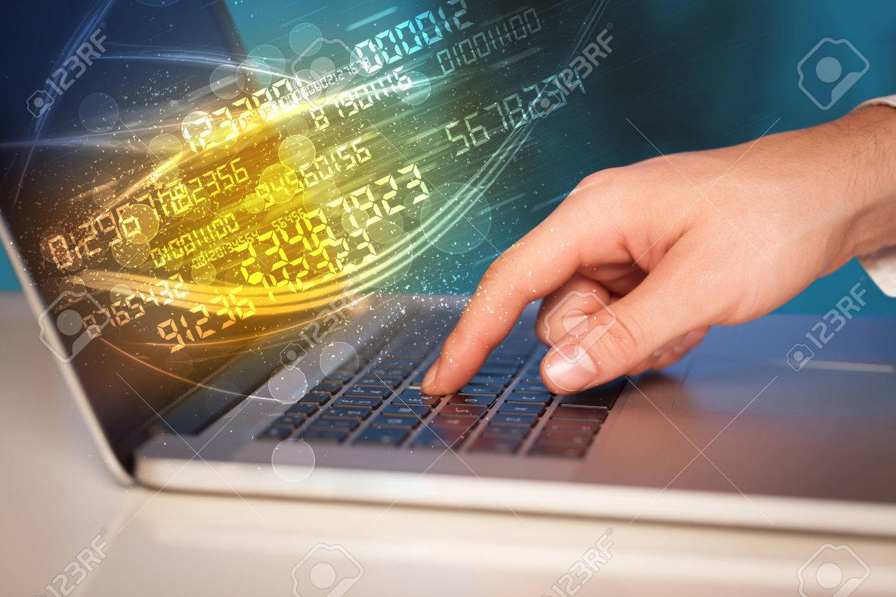 Man typing on modern notebook with future number technology data coming out Stock Photo - 43276018