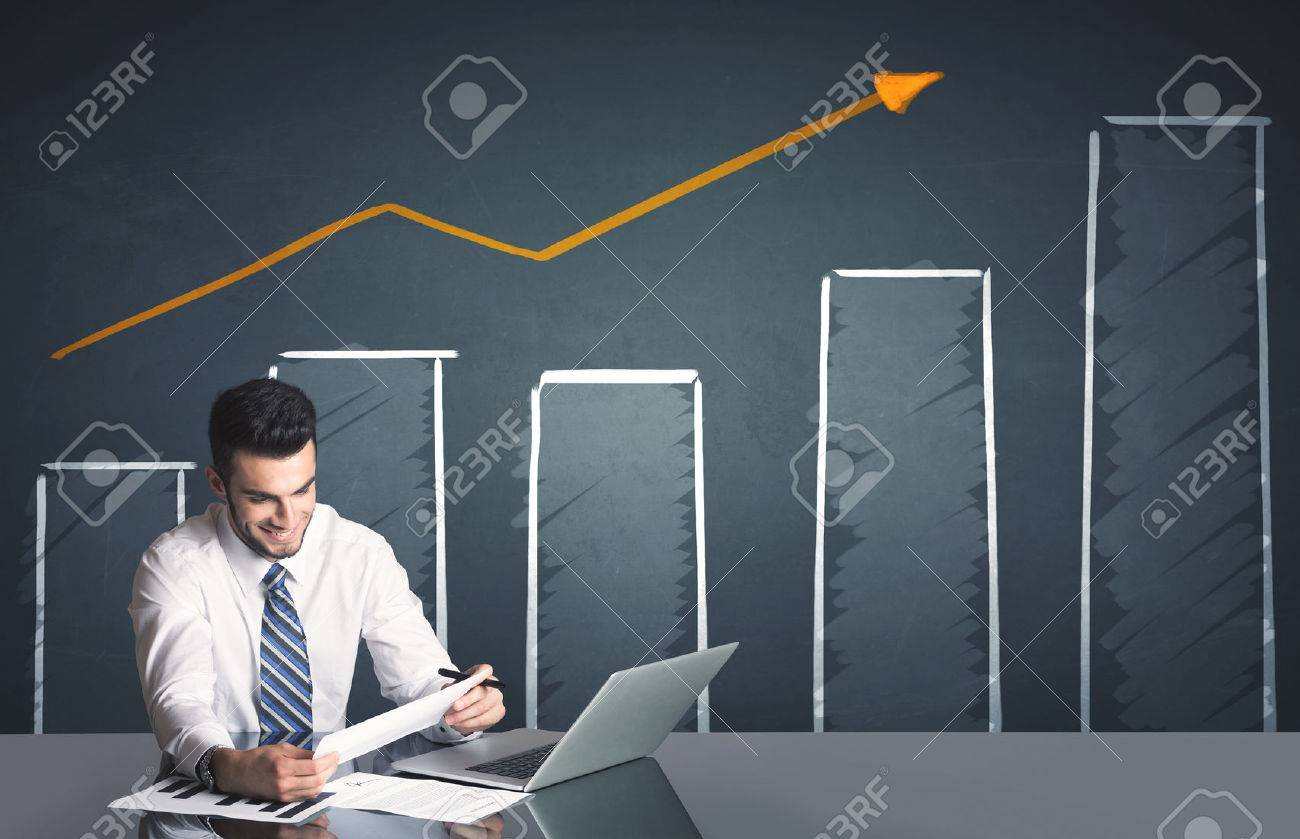 Successful businessman with business diagram in background Stock Photo - 44979037