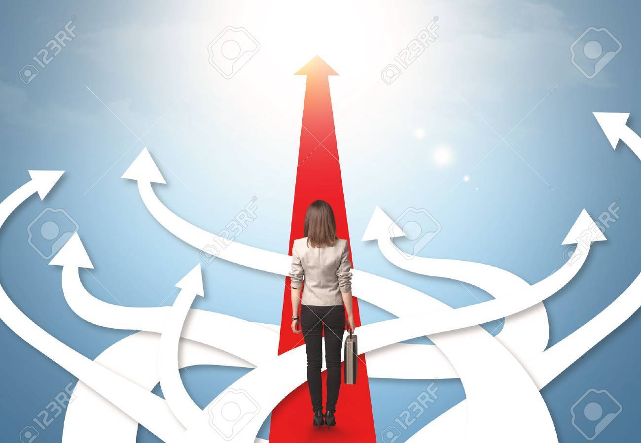 Concept of confused businesswoman with different direction arrows Stock Photo - 44979010