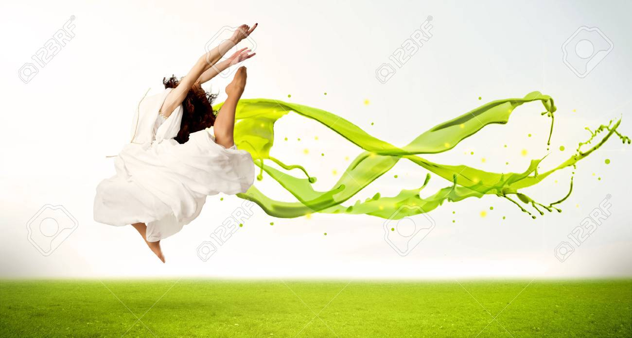 Pretty girl jumping with green abstract liquid dress concept in nature Stock Photo - 46390389