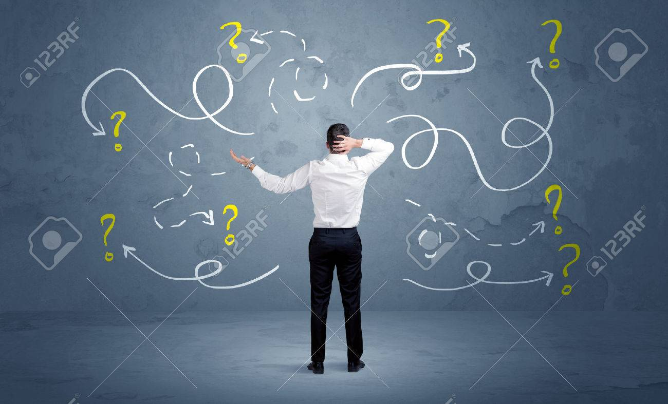 A salesman in doubt can not find the solution to the problem concept with curvy lined arrows and question marks drawn on urban wall Stock Photo - 48440222