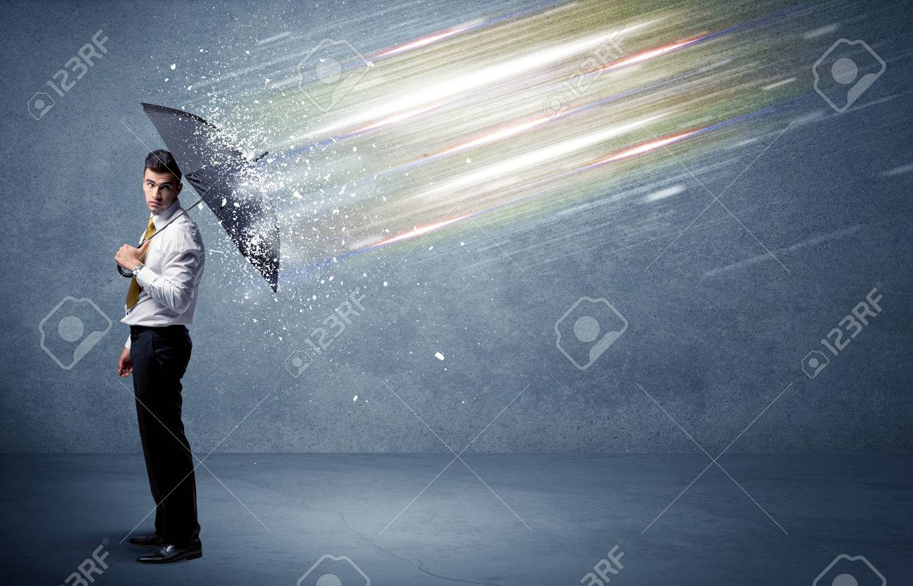 Business man defending light beams with umbrella concept on background Stock Photo - 48440175