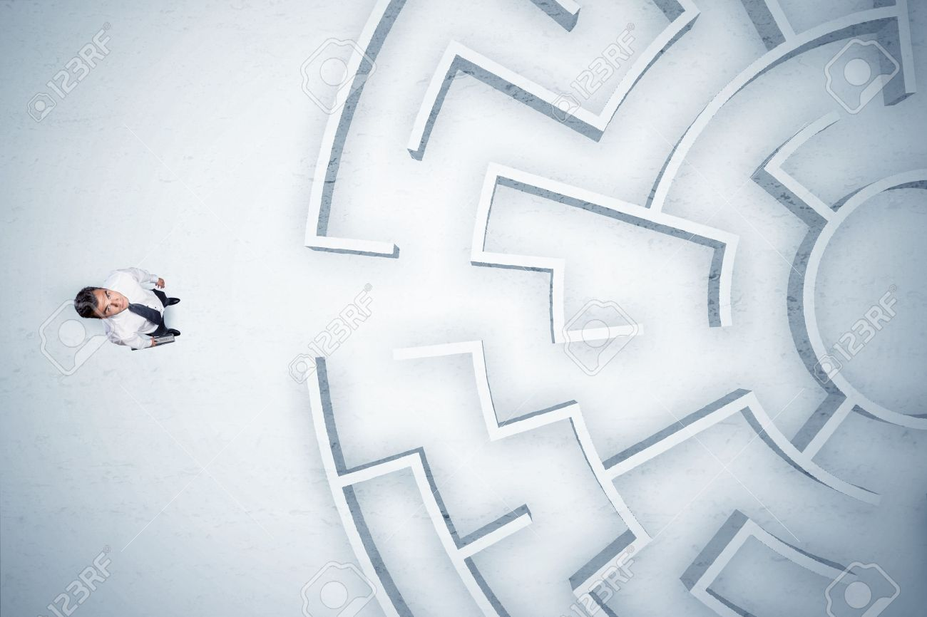 Stressful business man looking at circular maze with nowhere to go Stock Photo - 48982343