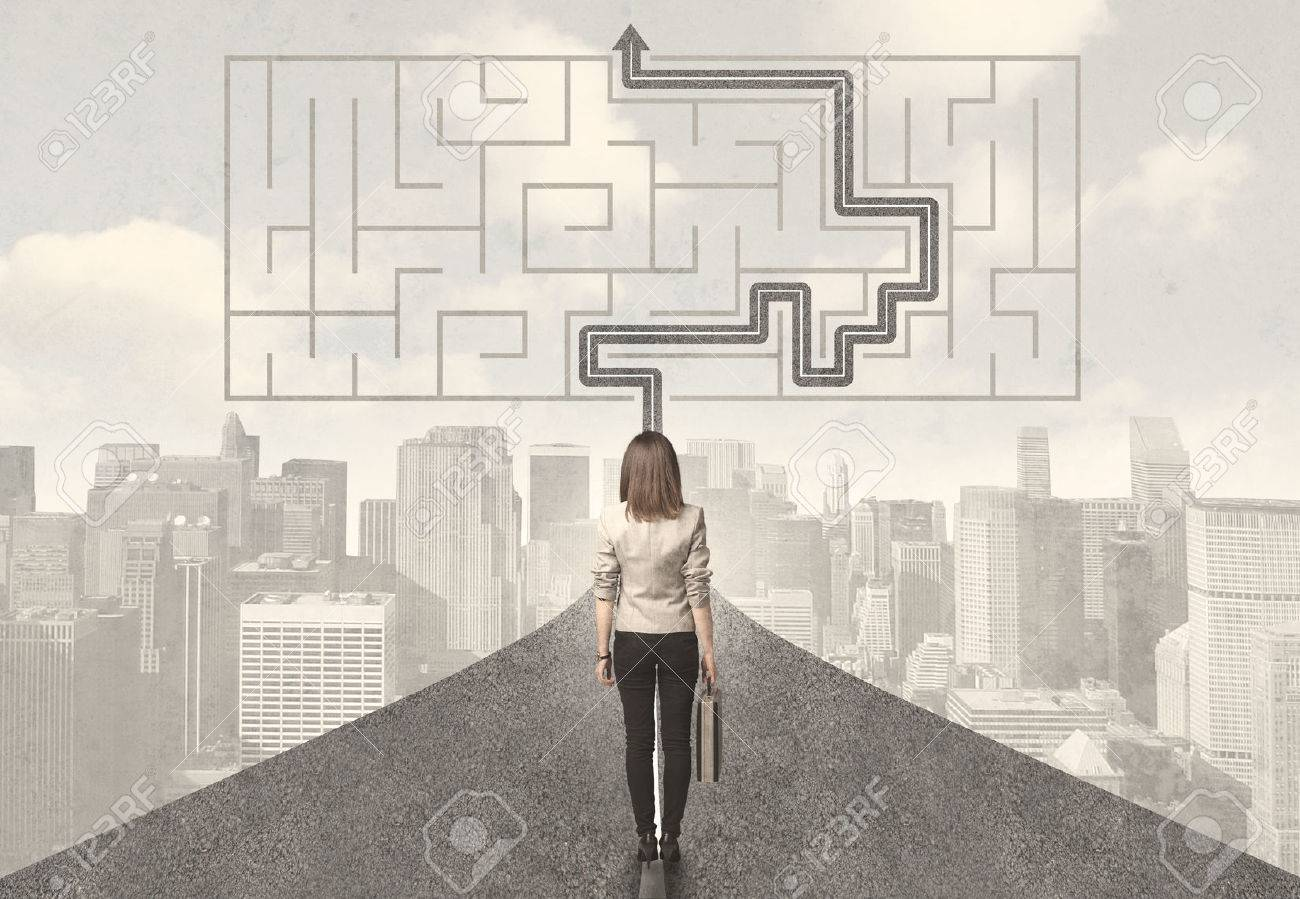Business woman looking at road with maze and solution concept Stock Photo - 49455721