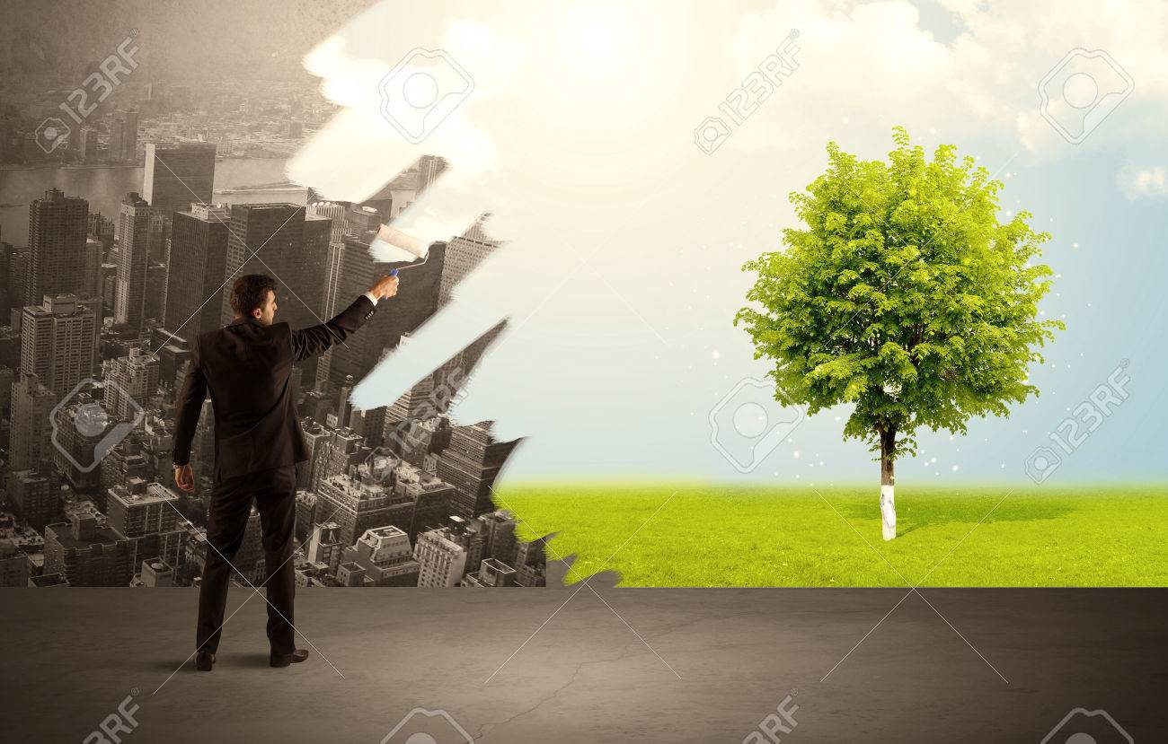 Businessman in elegant suit standing with his back, holding a roller and transforming the grey city landscape into green tree in bright nature environment concept Stock Photo - 49618321