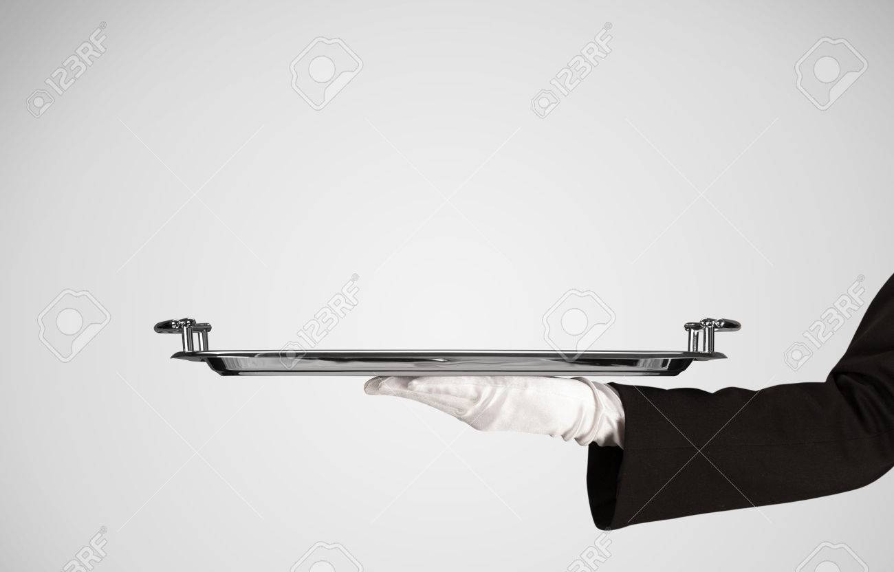 An elegant waiter business hand in white glove holding an empty plate with grey blank gradient background. Stock Photo - 49618560