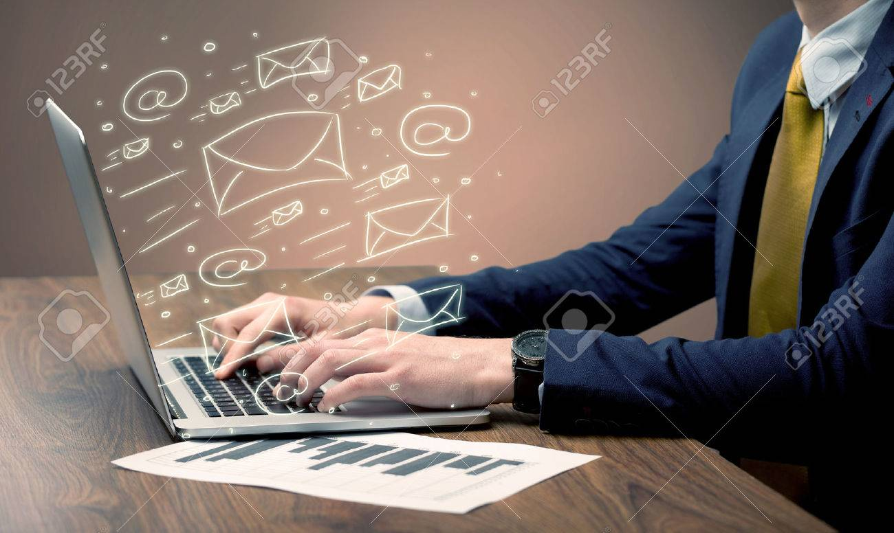 An office worker sending emails and communication with clients with the help of a portable laptop on desk concept Stock Photo - 50065259