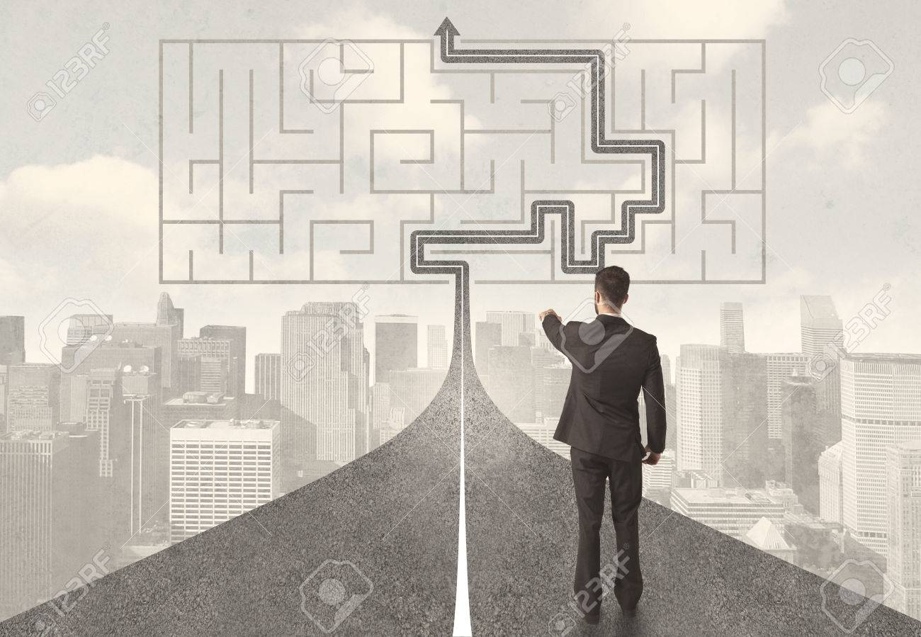 Businessman looking at road with maze and solution concept Stock Photo - 50234905