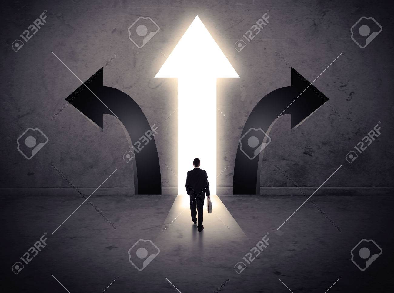 A businessman in doubt, having to choose between three different choices indicated by arrows pointing in opposite direction concept Stock Photo - 54828136