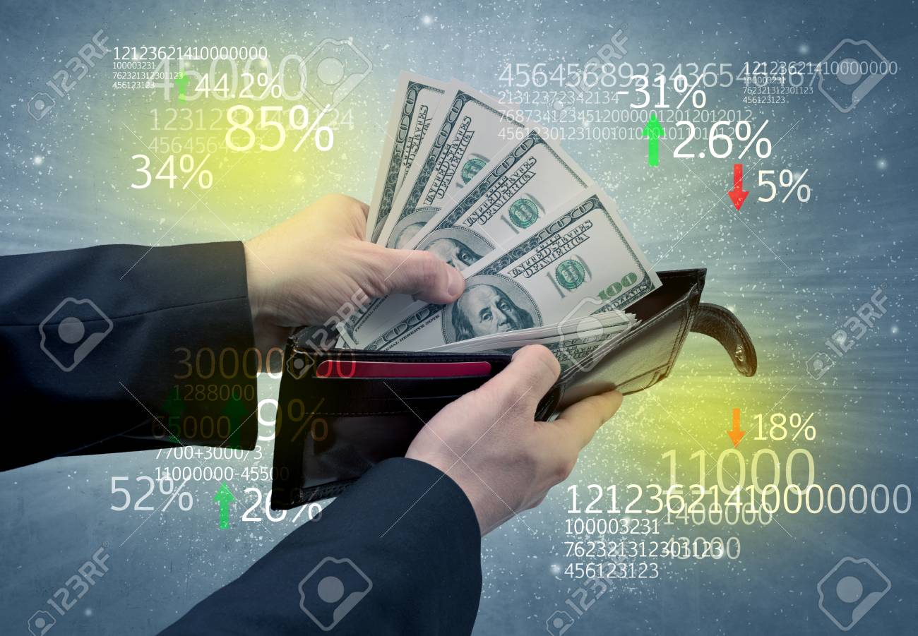 Hand takes out dollar from wallet with stock exchange theme